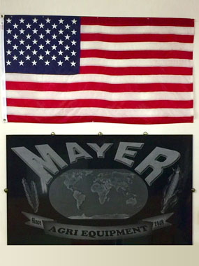 USA Flag and Mayer Agri Equipment sign